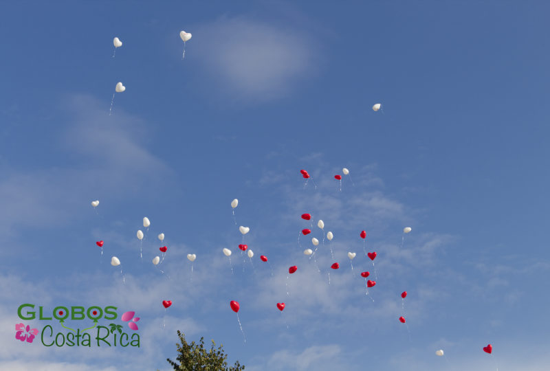 White and red helium balloon hearts for a wedding in Germany.