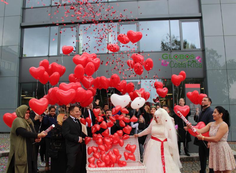 Red helium balloon hearts for a wedding in San Sebastian.